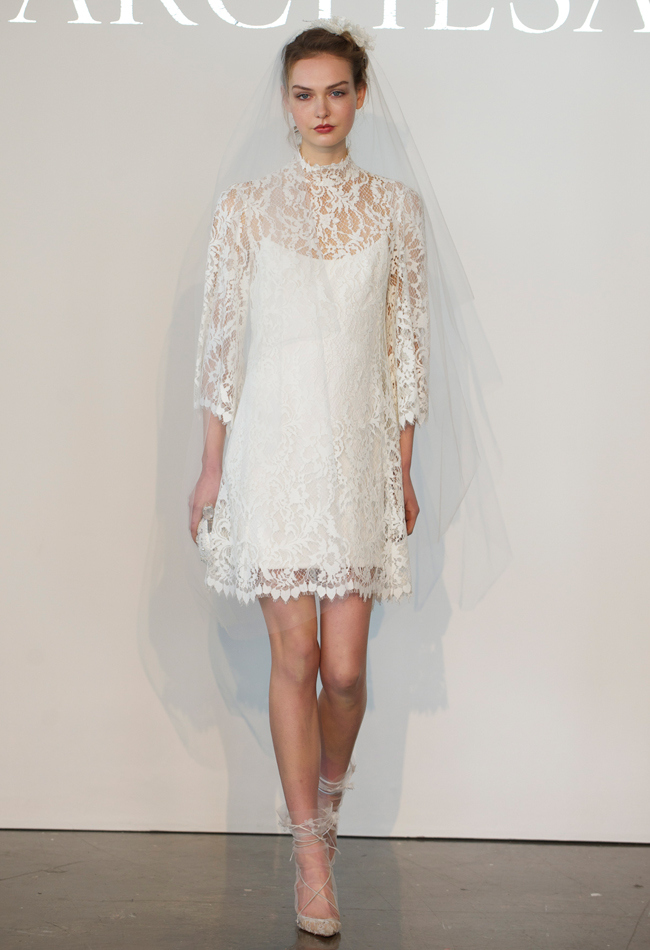 Knee-length fully re-embroidered Chantilly lace sheath wedding dress with an illusion high neckline and 3/4 length sleeves