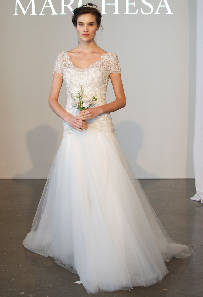 Tulle A-line wedding dress with a floral crystal bodice, v-neckline, and short sleeves