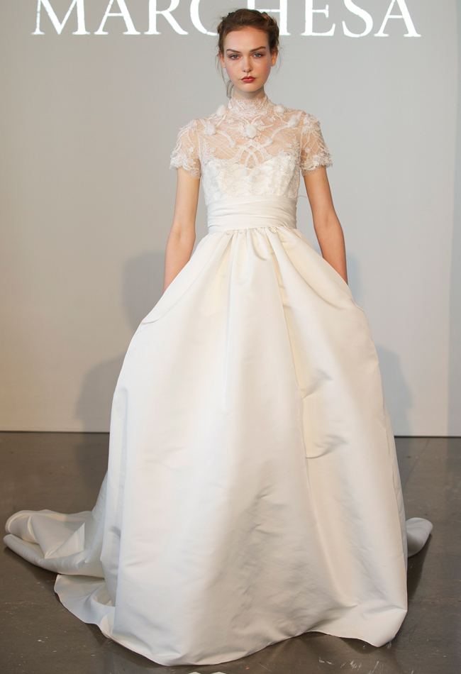 Chantilly lace ball gown wedding dress with a silk faille skirt, embroidered high-neck bodice, and short sleeves