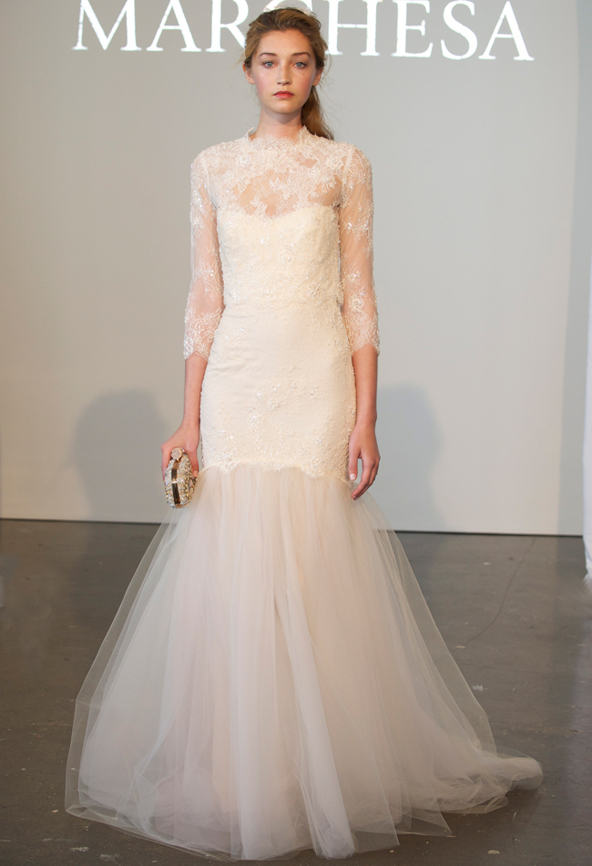 Lace mermaid wedding dress with a tulle skirt, three-quarter sleeves, and a sheer high neckline