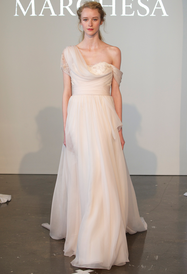One-shoulder blush silk chiffon A-line wedding dress with a floral lace embellished corset