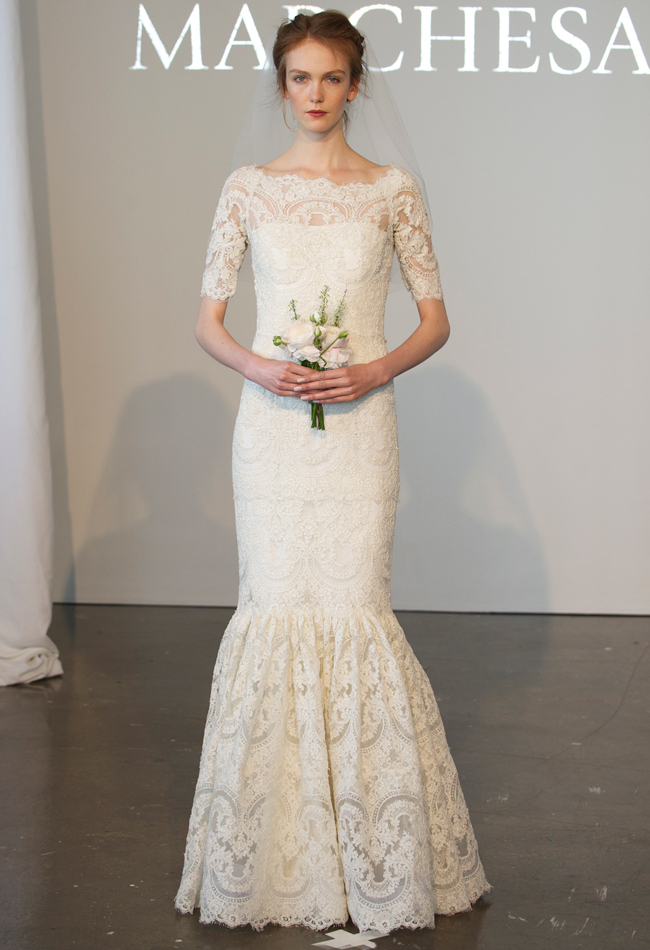 Fully embroidered corded lace mermaid wedding dress with a bateau neckline and elbow-length sleeves