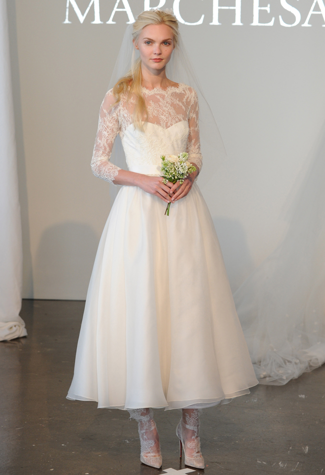 Corded lace tea-length A-line wedding dress with three-quarter length sleeves and a silk gauze skirt
