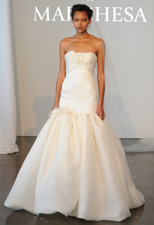 Strapless basket weave gazar mermaid wedding dress with a draped bodice and 3D lace details on the neckline and skirt