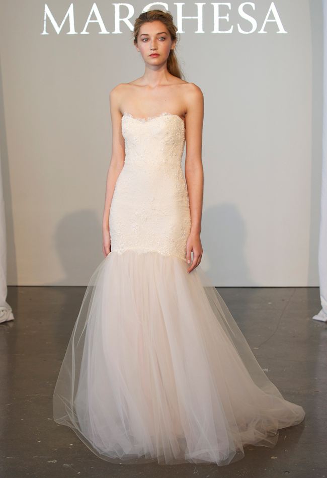 Strapless draped tulle A-line wedding dress with beaded lace details on the bodice and a textured skirt